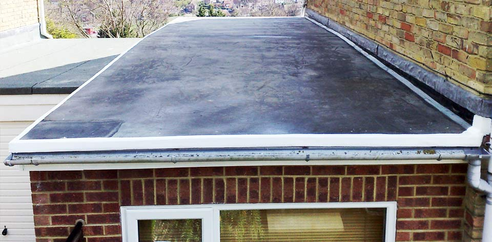 Here is an example of an Extention Flat Roof worked on in 2012 by Damario Asphalt.